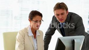 Business people talking together at desk