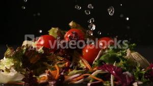Water dropping onto fresh salad