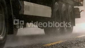 Heavy lorry driving over wet road