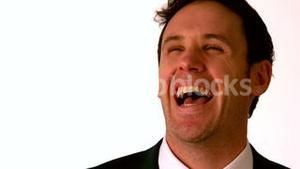 Happy businessman laughing on white background