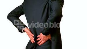 Businessman touching his painful lower back