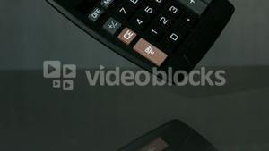 Calculator falling on black background