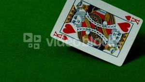 King of hearts falling on casino table