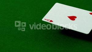 Ace of hearts falling on casino table
