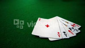 Full house hand falling on casino table