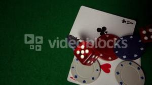 Cards chips and dice falling on casino table