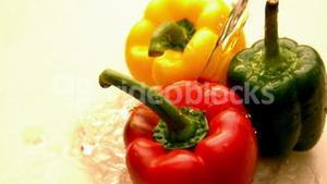 Water pouring on selection of peppers