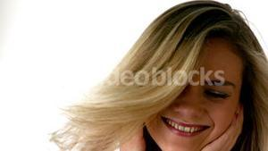 Pretty blonde listening to music shaking her head