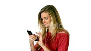Pretty blonde listening to music with smartphone
