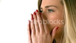 Pretty blonde sneezing on white background