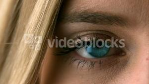 Pretty blonde opening her eye close up