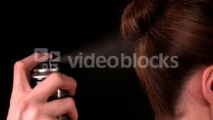 Hairspray spraying on models hairstyle