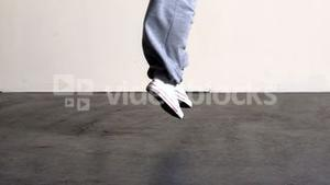 Lower half of sporty dancers feet jumping