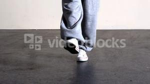 Lower half of sporty dancers feet moving