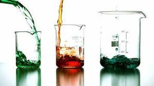 Chemical liquids pouring into beaker