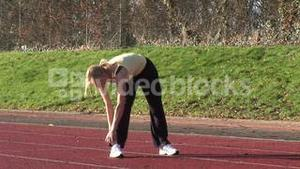Woman Running on a track