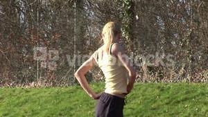 Woman running at track and field competition