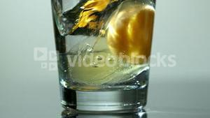 Effervescent vitamin tablet in glass of water