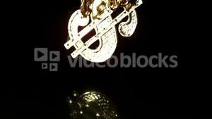 Gold dollar chain falling on black background