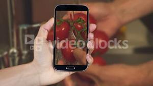 Hand showing cooking clips on smartphone