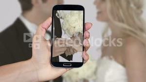 Hand showing wedding clips on smartphone