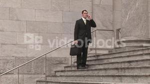 Man on Steps of Building