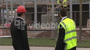Two engineers in discussion at a Construction Site