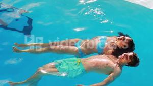 Couple floating in the swimming pool