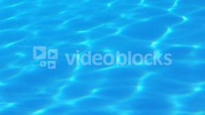 Light shining onto blue swimming pool