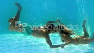 Couple kissing underwater in the swimming pool