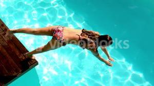 Brunette diving in the swimming pool