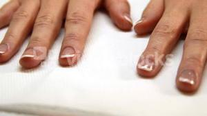 Hands showing fresh french manicure