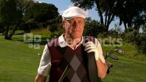 Mature golfer walking on the golf course