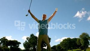 Ecstatic golfer jumping up and cheering