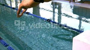 Fit swimmer diving into the swimming pool