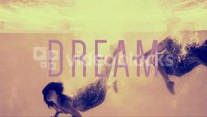 Women in evening gowns diving into pool with dream text