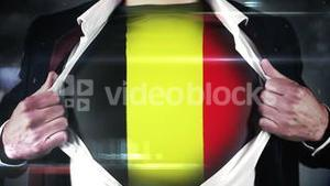 Businessman opening shirt to reveal belgium flag