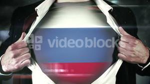 Businessman opening shirt to reveal russian flag