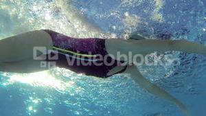 Athletic swimmer swimming in pool