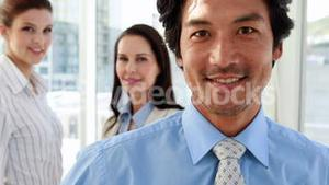 Attractive business team smiling at camera