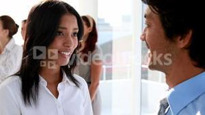 Business partners smiling and chatting