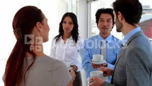 Business team having coffee and chatting