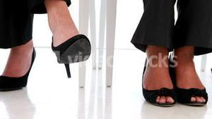 Businesswoman shaking her feet nervously