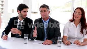 Interview panel explaining to applicant
