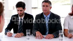 Interview panel speaking to applicant