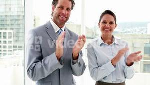Business people applauding the camera