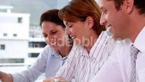 Business team working together at a meeting with laptop