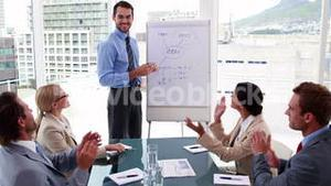 Business team applauding manager after presentation