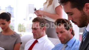 Business team sitting in staff room