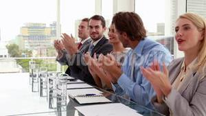 Interview panel applauding the applicant